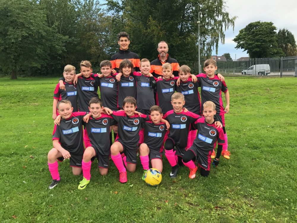 Wingerworth JSA FC U11 Wolves wearing their football kit as sponsored by The Sanitaryware Supplies Company